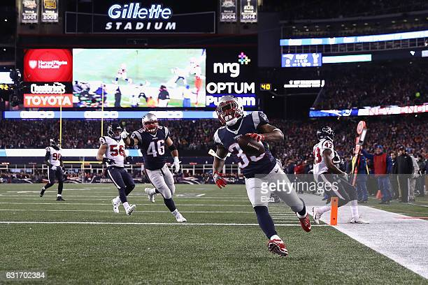 Dion Lewis of the New England Patriots scores a touchdown in the first quarter against the Houston Texans during the AFC Divisional Playoff Game at...