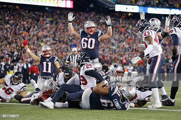 Dion Lewis of the New England Patriots scores a touchdown in the fourth quarter against the Houston Texans during the AFC Divisional Playoff Game at...