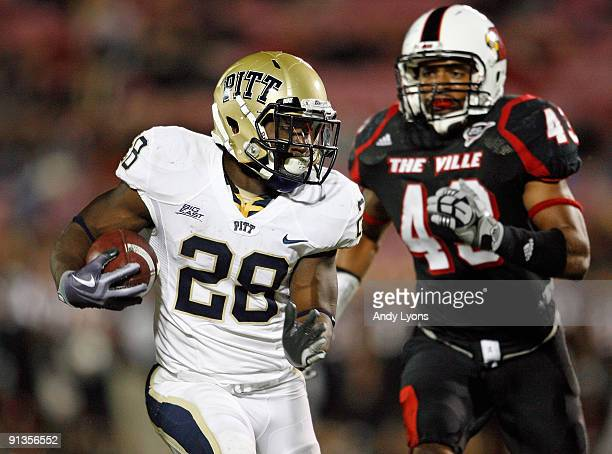 Dion Lewis of the Pittsburgh Panthers runs with the ball during the Big East Conference game against the Louisville Cardinals at Papa John's Cardinal...