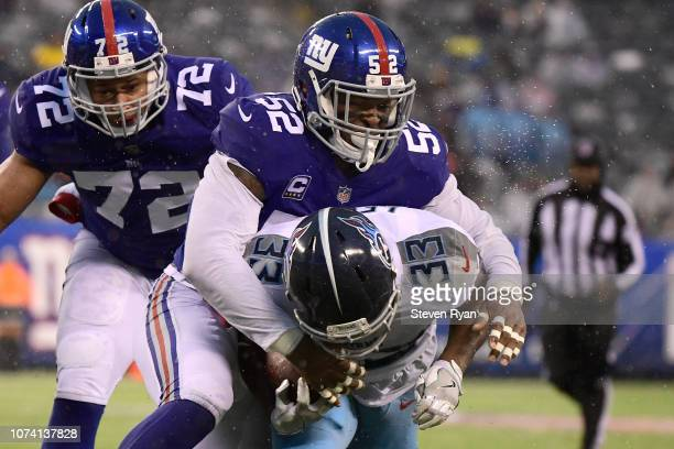 Dion Lewis of the Tennessee Titans is tackled by Alec Ogletree of the New York Giants during the second half at MetLife Stadium on December 16 2018...
