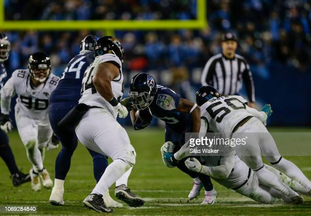 Dion Lewis of the Tennessee Titans is tackled by Myles Jack of the Jacksonville Jaguars during the fourth quarter at Nissan Stadium on December 6...