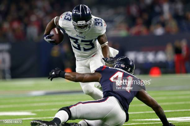 Dion Lewis of the Tennessee Titans rushes the ball in the first quarter defended by Zach Cunningham of the Houston Texans at NRG Stadium on November...