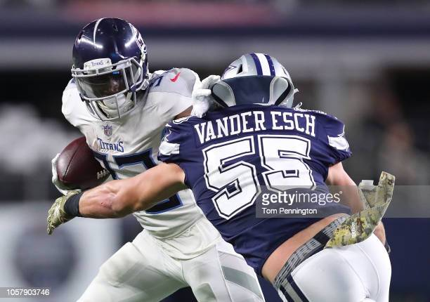 Dion Lewis of the Tennessee Titans tries to hold off Leighton Vander Esch of the Dallas Cowboys on a run in he fourth quarter of a football game at...