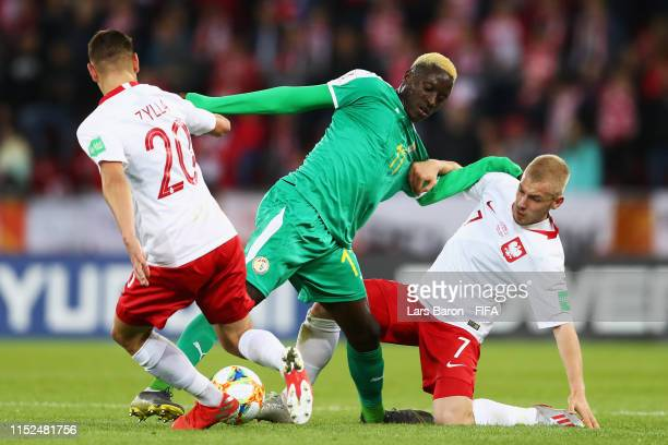 Dion Lopy of Senegal battles for the ball with Marcel Zylla and Tomasz Makowski of Poland during the 2019 FIFA U20 World Cup group A match between...