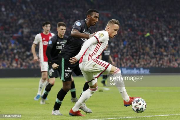 Dion Malone of ADO Den Haag Noa Lang of Ajax during the Dutch Eredivisie match between Ajax Amsterdam and ADO Den Haag at the Johan Cruijff Arena on...