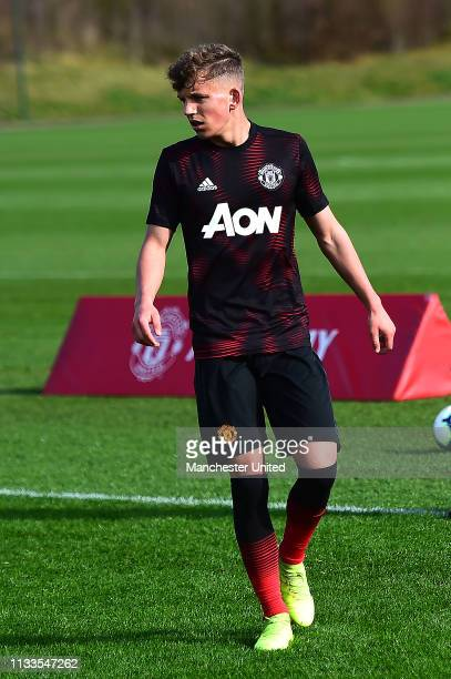 Dion McGhee of Manchester United U18s warms up ahead of the U18 Premier League match between Manchester United U18s and West Bromwich Albion U18s at...