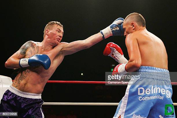Dion McNabney of New Zealand punches Peter Mitrevski Jnr of Australia during their light middleweight fight at the Sydney Entertainment Centre on...