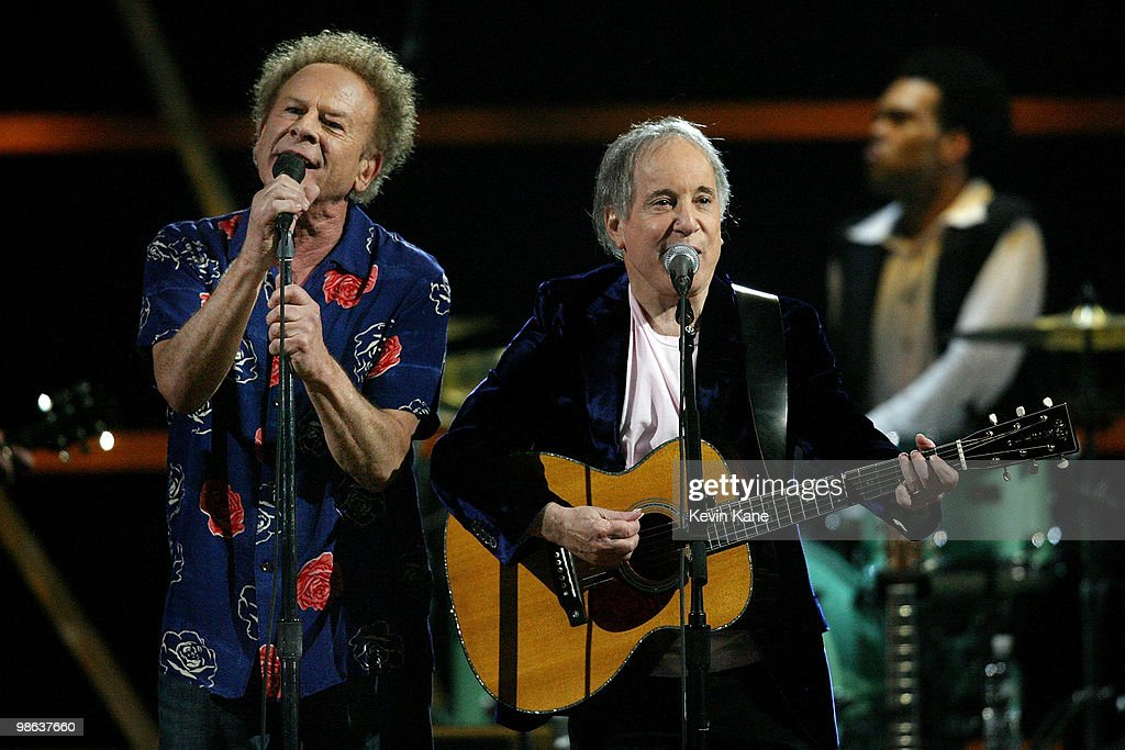 Dion (L) performs onstage at the 25th Anniversary Rock & Roll Hall of Fame Concert at Madison Square Garden on October 29, 2009 in New York City.