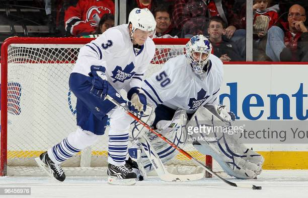Dion Phaneuf and Jonas Gustavsson of the Toronto Maple Leafs defend the net against the New Jersey Devils at the Prudential Center on February 5,...