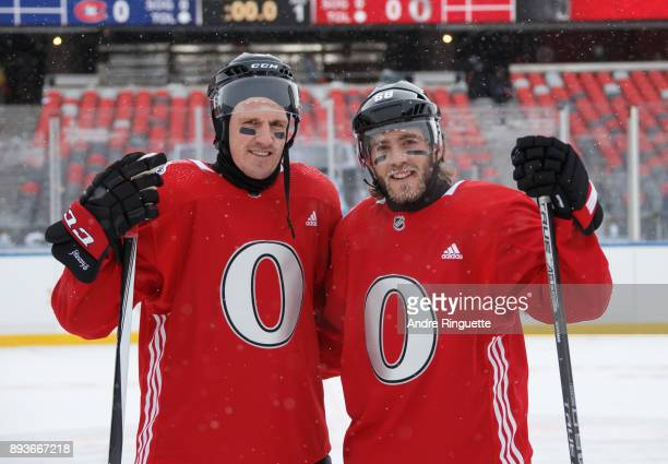 Dion Phaneuf and Mike Hoffman of the Ottawa Senators pose for a picture following a practice session ahead of the Scotiabank NHL100 Classic at...