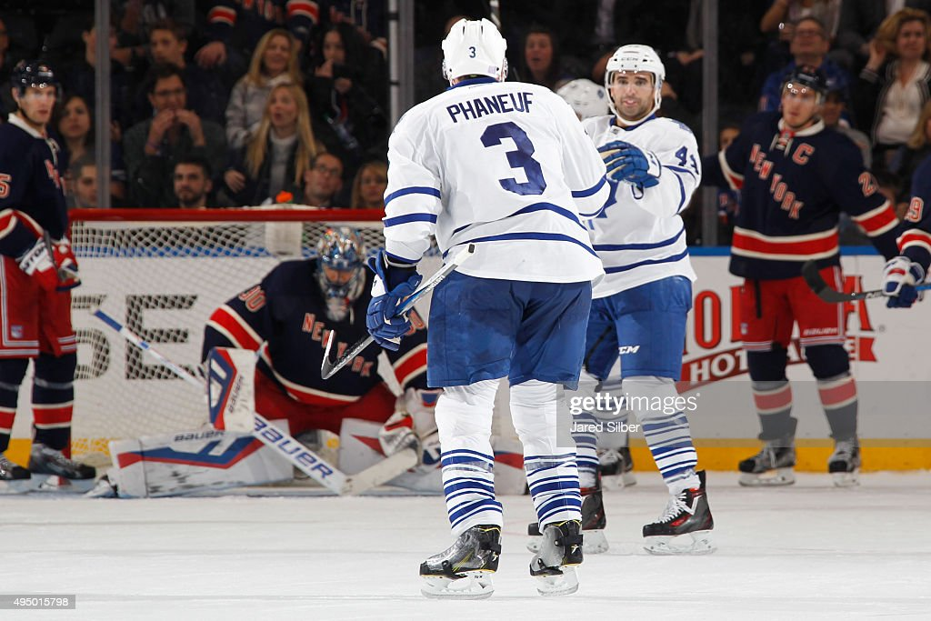 Dion Phaneuf #3 and Nazem Kadri #43 of the Toronto Maple Leafs celebrate after scoring in the third period against Henrik Lundqvist #30 of the New York Rangers at Madison Square Garden on October 30, 2015 in New York City.