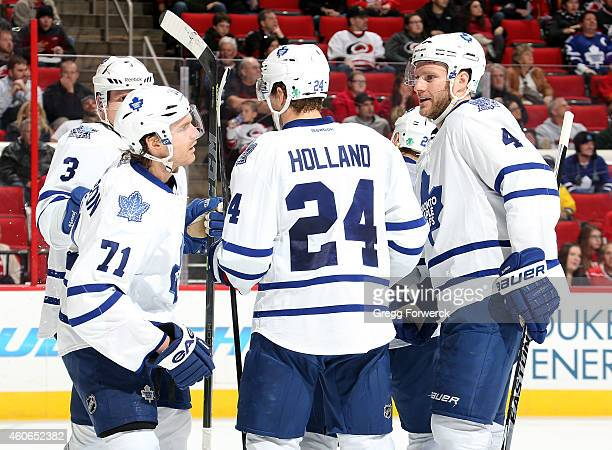 Dion Phaneuf David Clarkson Peter Holland Cody Franson and Daniel Winnik of the Toronto Maple Leafs gather to celebrate Phaneuf's secondperiod goal...
