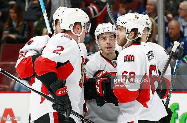 Dion Phaneuf Mike Hoffman and JeanGabriel Pageau congratulate Mark Stone of the Ottawa Senators who scored against the Vancouver Canucks during their...