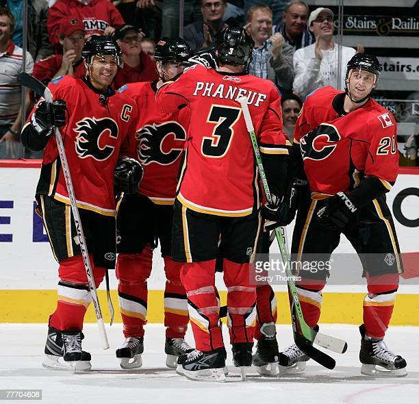 Dion Phaneuf of the Calgary Flames and teammates celebrate after the victory against the Nashville Predators on October 30 2007 at the Pengrowth...