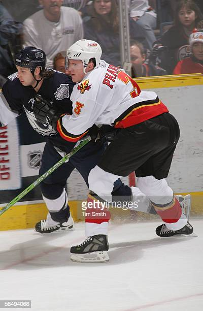Dion Phaneuf of the Calgary Flames battles against the boards with Ryan Smyth of the Edmonton Oilers during their game at Rexall Place December 19...