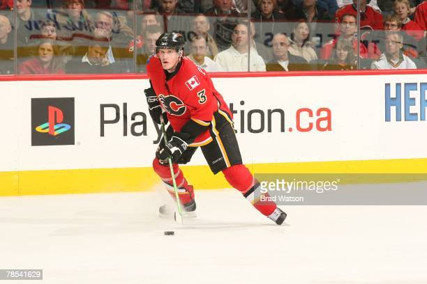 Dion Phaneuf of the Calgary Flames carries the puck against the St. Louis Blues on December 4, 2007 at Pengrowth Saddledome in Calgary, Alberta,...