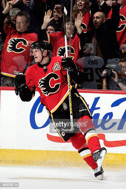 Dion Phaneuf of the Calgary Flames celebrates a goal against the Buffalo Sabres on January 28 2009 at Pengrowth Saddledome in Calgary Alberta Canada