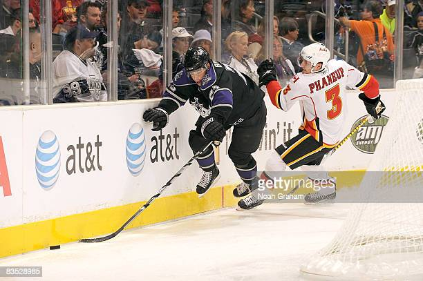 Dion Phaneuf of the Calgary Flames collides with Dustin Brown of the Los Angeles Kings into the boards during the game on November 1, 2008 at Staples...