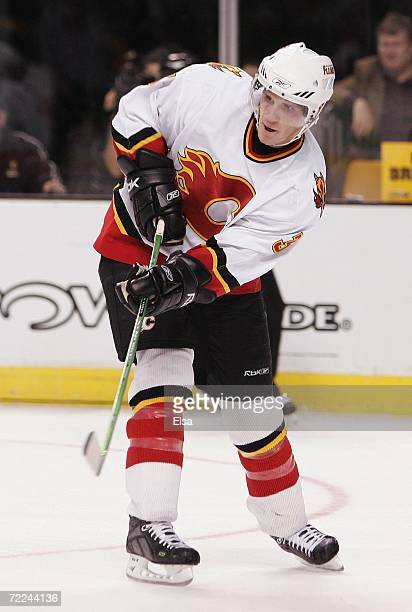 Dion Phaneuf of the Calgary Flames follows through on a pass against the Boston Bruins on October 19 2006 at TD Banknorth Garden in Boston...