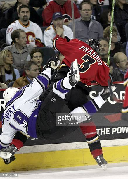 Dion Phaneuf of the Calgary Flames hits Sean Avery of the Los Angeles Kings to the ice on March 29 2006 at the Pengrowth Saddledome in Calgary...