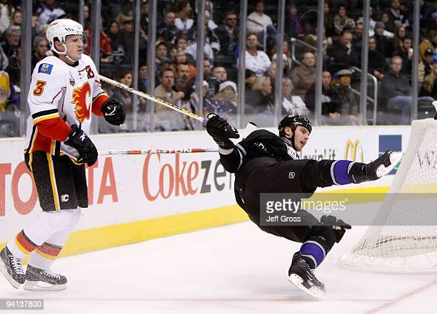 Dion Phaneuf of the Calgary Flames interferes with Raitis Ivanans of the Los Angeles Kings in the first period at Staples Center on December 7, 2009...