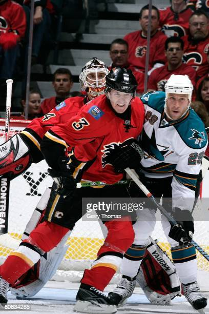 Dion Phaneuf of the Calgary Flames jostles for position in front of the net against Ryan Clowe of the San Jose Sharks during game six of the 2008 NHL...