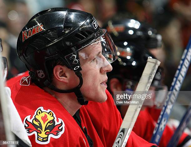 Dion Phaneuf of the Calgary Flames looks on from the bench during their NHL game against the Boston Bruins at Pengrowth Saddledome on December 17...