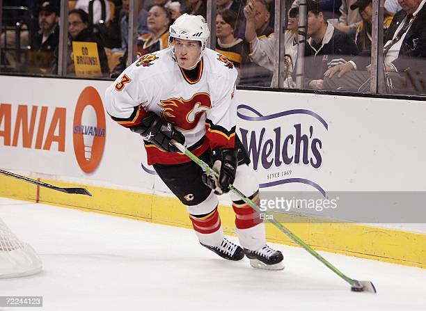 Dion Phaneuf of the Calgary Flames skates the puck around the net against the Boston Bruins on October 19 2006 at TD Banknorth Garden in Boston...