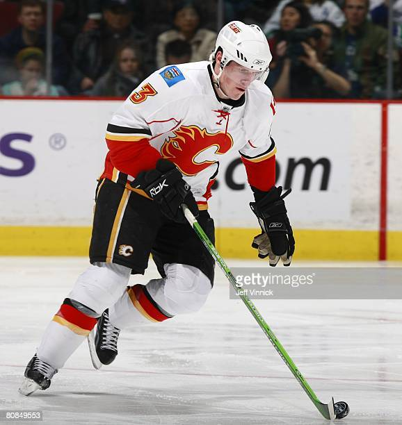 Dion Phaneuf of the Calgary Flames skates up ice with the puck during their game against the Vancouver Canucks at General Motors Place on April 5,...