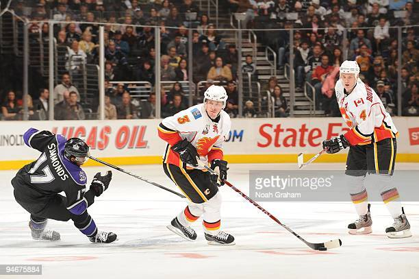 Dion Phaneuf of the Calgary Flames skates with the puck against Wayne Simmonds of the Los Angeles Kings at Staples Center on November 21, 2009 in Los...
