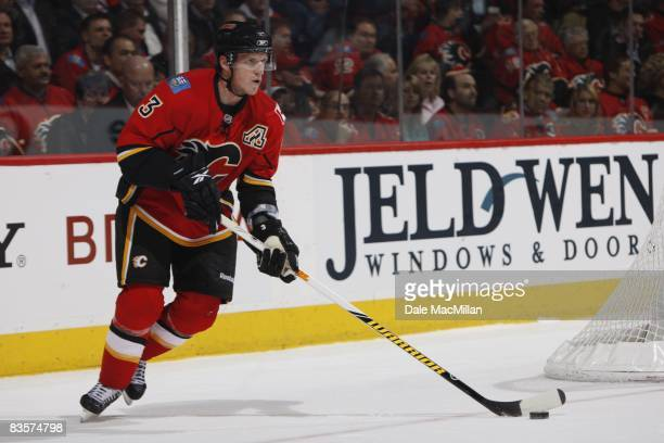 Dion Phaneuf of the Calgary Flames skates with the puck during the game against the Colorado Avalanche on October 28 2008 at the Pengrowth Saddledome...