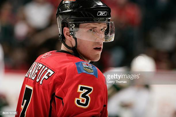 Dion Phaneuf of the Calgary Flames takes a break during a stoppage in play against the Minnesota Wild on March 22, 2008 at Pengrowth Saddledome in...