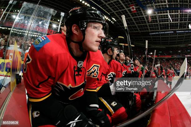 Dion Phaneuf of the Calgary Flames watches the game from the bench in between shifts against the St. Louis Blues on March 20, 2009 at Pengrowth...
