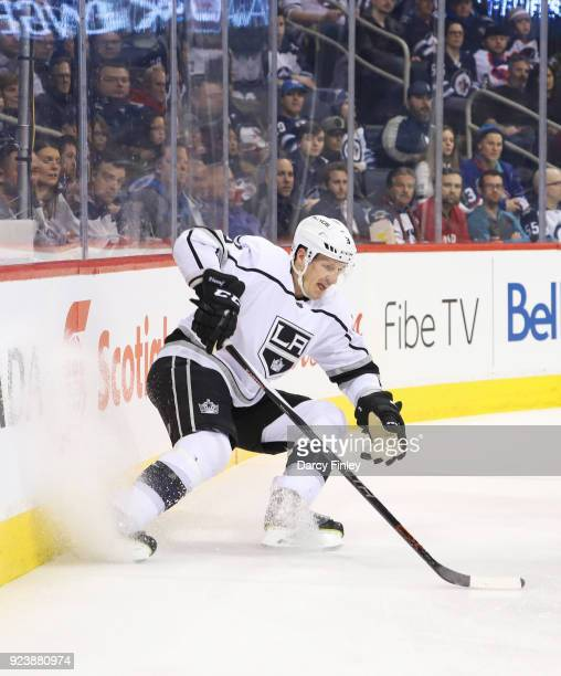 Dion Phaneuf of the Los Angeles Kings plays the puck behind the net during third period action against the Winnipeg Jets at the Bell MTS Place on...