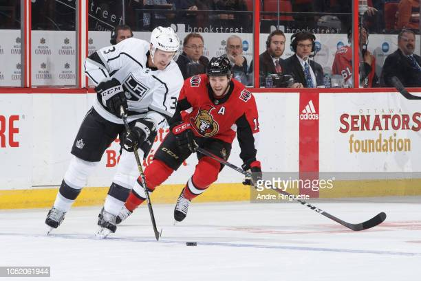 Dion Phaneuf of the Los Angeles Kings stickhandles the puck against Zack Smith of the Ottawa Senators at Canadian Tire Centre on October 13 2018 in...