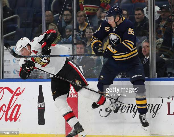 Dion Phaneuf of the Ottawa Senators and Rasmus Ristolainen of the Buffalo Sabres during the game at the KeyBank Center on December 12 2017 in Buffalo...