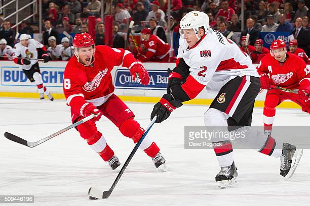 Dion Phaneuf of the Ottawa Senators controls the puck in front of Justin Abdelkader of the Detroit Red Wings during an NHL game at Joe Louis Arena on...