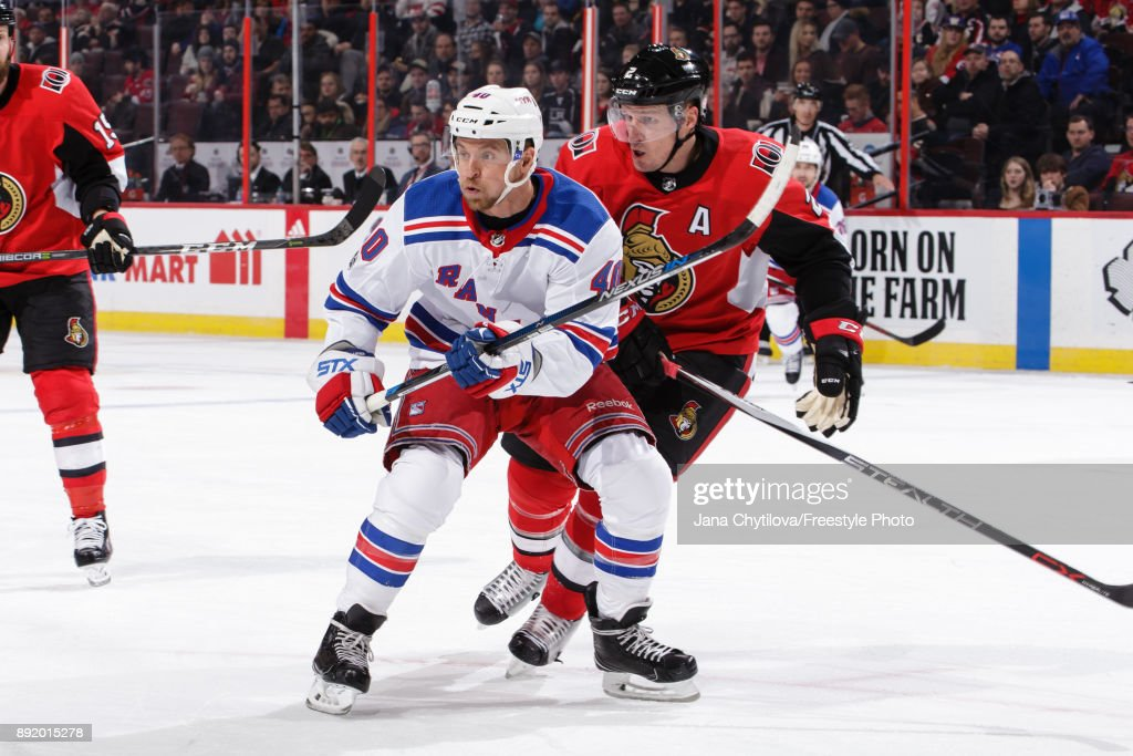 Dion Phaneuf #2 of the Ottawa Senators skates against Michael Grabner #40 of the New York Rangers at Canadian Tire Centre on December 13, 2017 in Ottawa, Ontario, Canada.