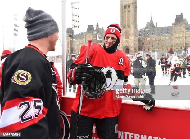 Dion Phaneuf of the Ottawa Senators talks with former teammate Chris Neil during the 2017 Scotiabank NHL100 Classic Ottawa Senators practice on...