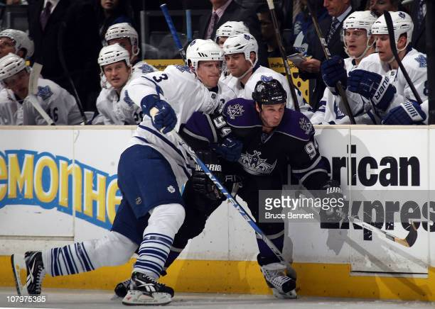 Dion Phaneuf of the Toronto Maple Leafs rides Ryan Smyth of the Los Angeles Kings into the boards at the Staples Center on January 10 2011 in Los...