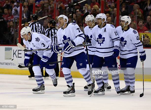Dion Phaneuf of the Toronto Maple Leafs skates off the ice with teammates after scoring a second period goal against the Washington Capitals at...
