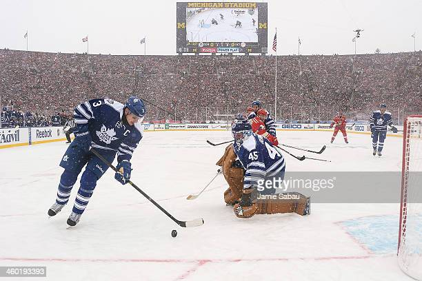 Dion Phaneuf of the Toronto Maple Leafs skates with the puck past goaltender Jonathan Bernier of the Toronto Maple Leafs in a game against the...