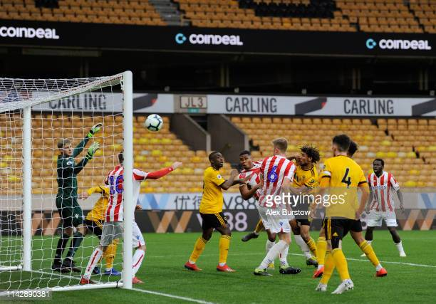 Dion Sanderson of Wolverhampton Wanderers scores his team's first goal during the Premier League 2 match between Wolverhampton Wanderers U23 and...