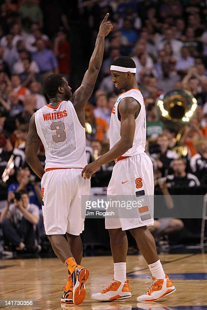 Dion Waiters and CJ Fair of the Syracuse Orange celebrate after defeating Wisconsin Badgers during their 2012 NCAA Men's Basketball East Regional...