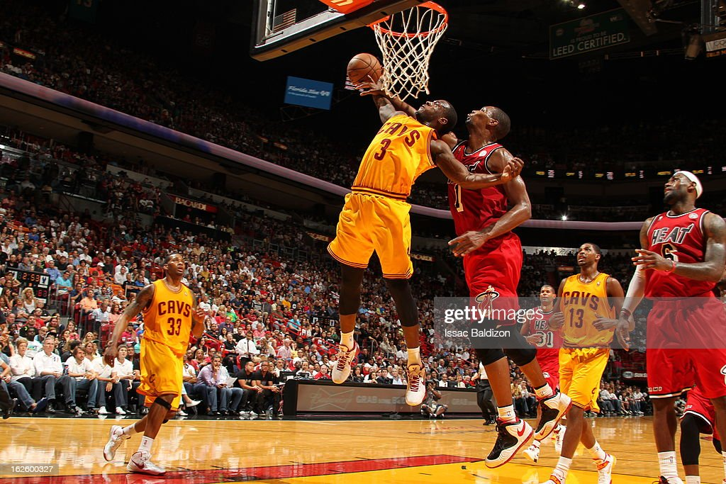 Dion Waiters #3 of the Cleveland Cavaliers goes to the basket against Chris Bosh #1 of the Miami Heat during a game between the Cleveland Cavaliers and the Miami Heat on February 24, 2013 at American Airlines Arena in Miami, Florida.