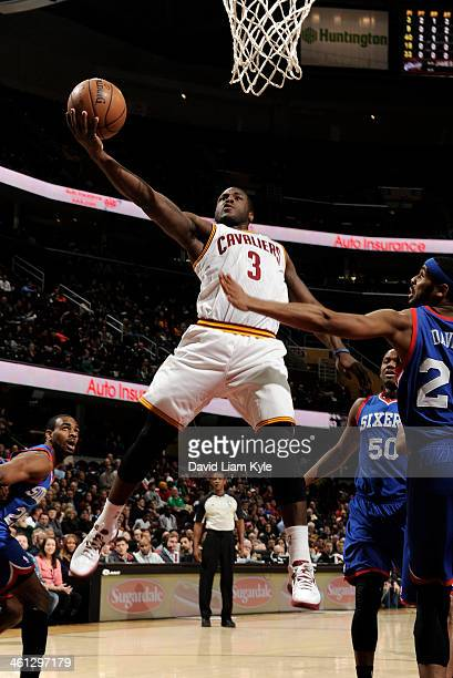 Dion Waiters of the Cleveland Cavaliers goes up for the shot against Brandon Davies of the Philadelphia 76ers at The Quicken Loans Arena on January 7...