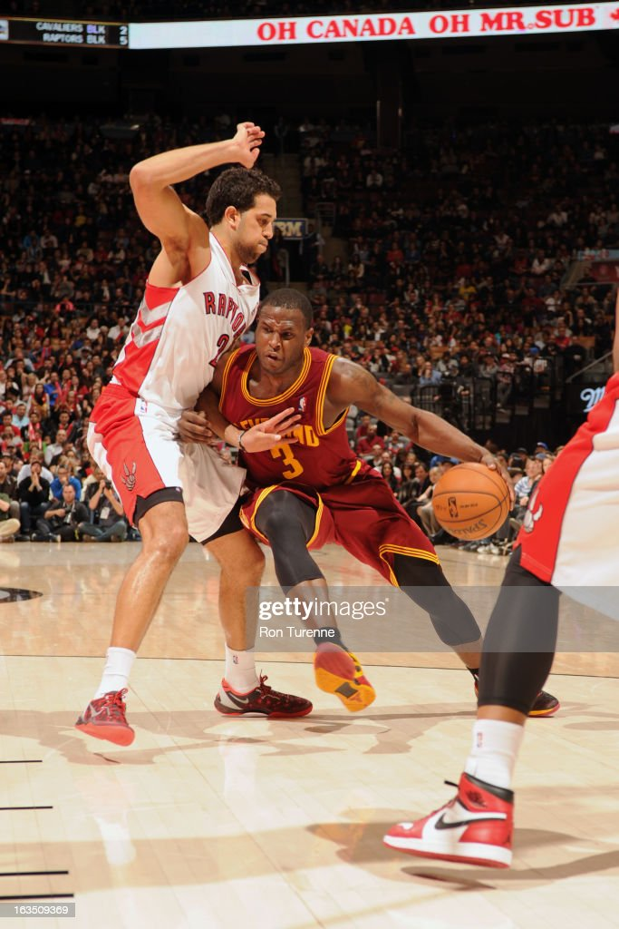 Dion Waiters #3 of the Cleveland Cavaliers handles the ball against Landry Fields #2 of the Toronto Raptors on March 10, 2013 at the Air Canada Centre in Toronto, Ontario, Canada.