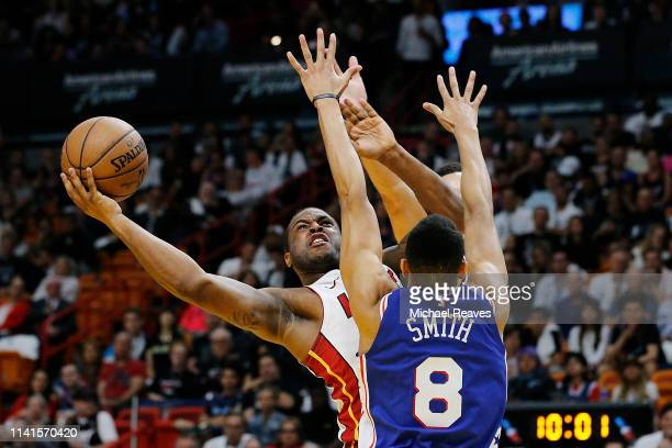 Dion Waiters of the Miami Heat attempts a layup against Zhaire Smith of the Philadelphia 76ers during the first half at American Airlines Arena on...