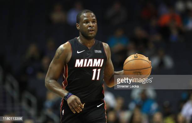 Dion Waiters of the Miami Heat brings the ball up the court against the Charlotte Hornets during their game at Spectrum Center on October 09 2019 in...