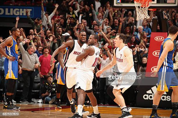 Dion Waiters of the Miami Heat celebrates with his team after making the game winning shot during the game against the Golden State Warriors on...